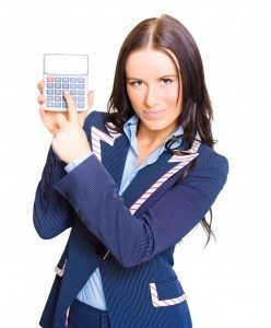 woman shows som numbers on her calculator. she looks confident about her results